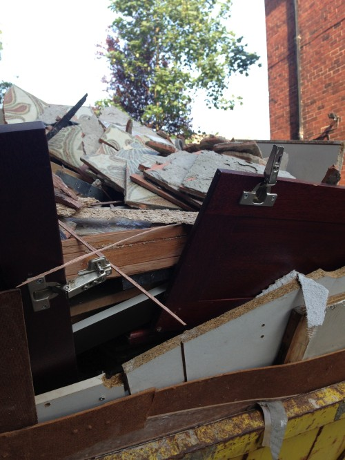 The overflowing skip indicated that the old kitchen had been ripped out.