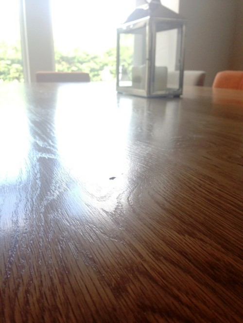 A wooden table varnished with clear laquer