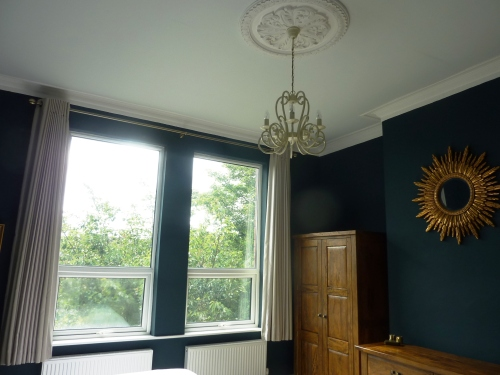 Farrow and Ball Hague Blue bedroom with cabbage White ceiling colour